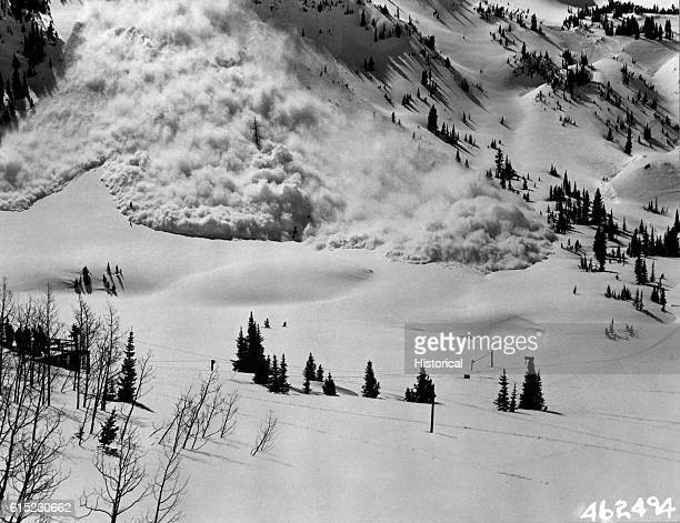 A giant avalanche roars down a mountain 10 seconds after a 75 millimeter shell explodes in a suspected wind slab area Avalanche control measures such...