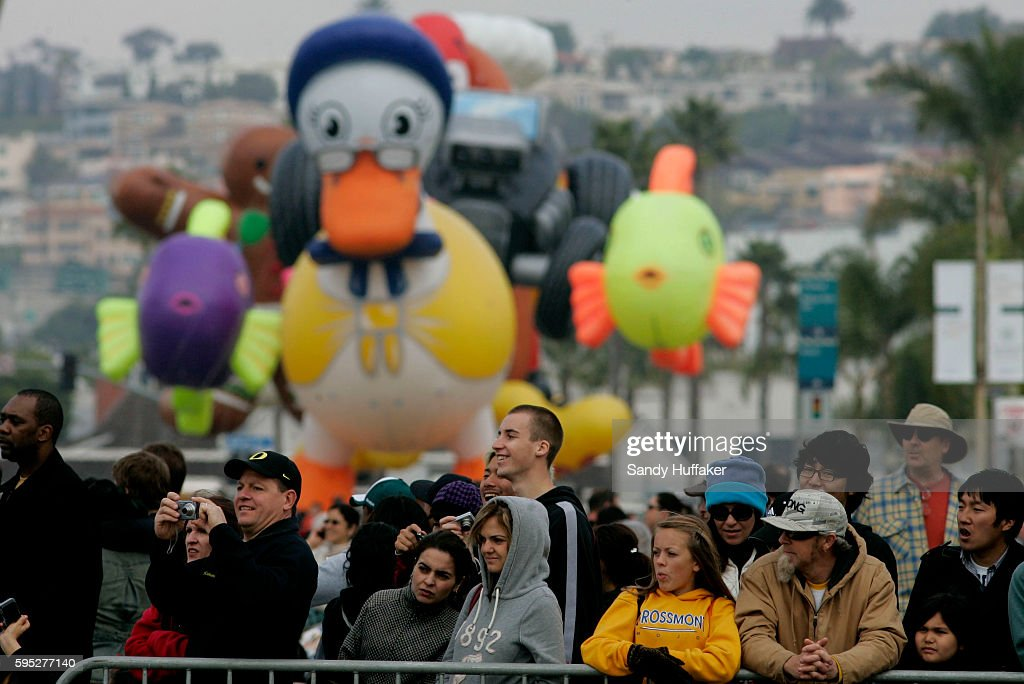 Giant Balloon floats wait in line to march down Harbor Blvd during the Pacific Life Holiday Bowl Parade in San Diego California Arizona and Nebraska...