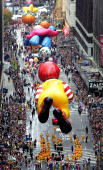 Giant balloons float down Broadway during the 78th Annual Macy's Thanksgiving Day Parade November 25 2004 in New York City Thousands attended the...
