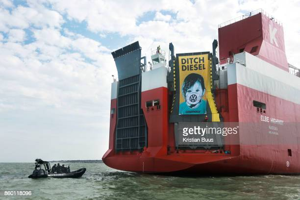 A giant banner at the back of the cargo ship calling for VW to ditch diesel September 21st 2017 Thames Estuary Kent United Kingdom Greenpeace...