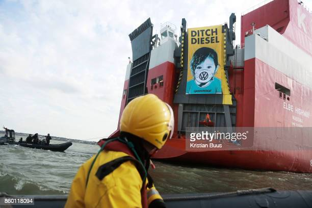 A giant banner at the back of the cargo ship Elbe Highway calling for VW to ditch diesel September 21st 2017 Thames Estuary Kent United Kingdom...