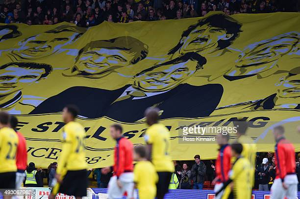 A giant banner with former manager Graham Taylor is passed over the crowd prior to the Barclays Premier League match between Watford and Arsenal at...