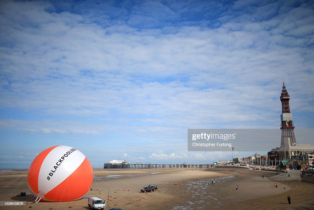 A giant beach ball sits on the beach next to Blackpool promenade on August 15, 2014 in Blackpool, England. The ball measured a height of 16.6 meters, beating the previous world record of 15.8 meters. The world record attempt is part of the #Blackpoolsback campaign which has stated that the seaside resort has recently had the highest number of visitors in decades.