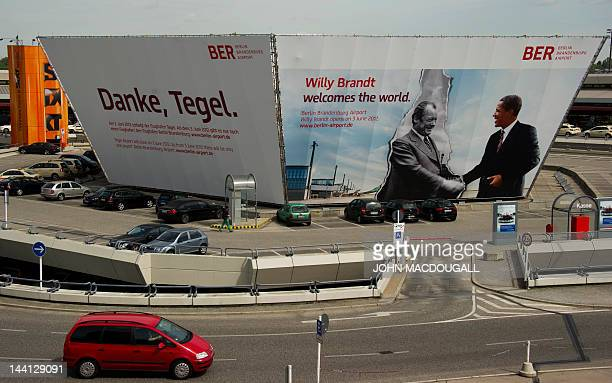 A giant billboard features likenesses of former German chancellor Willy Brandt and US President Barack Obama as it advertises Berlin's new Willy...