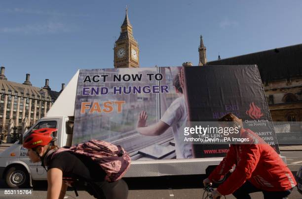 A giant billboard inviting the public to fast in solidarity with Britons going hungry and calling on the government to take action passes the Houses...