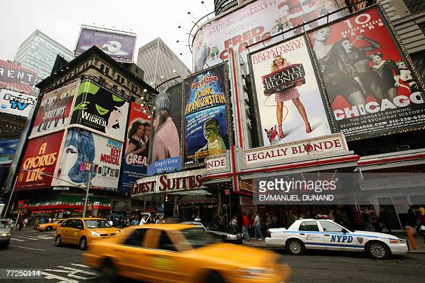 Giant billboards advertise theater and musical shows around Time Square on Broadway Avenue the heart of the US theatre industry in New York 10...