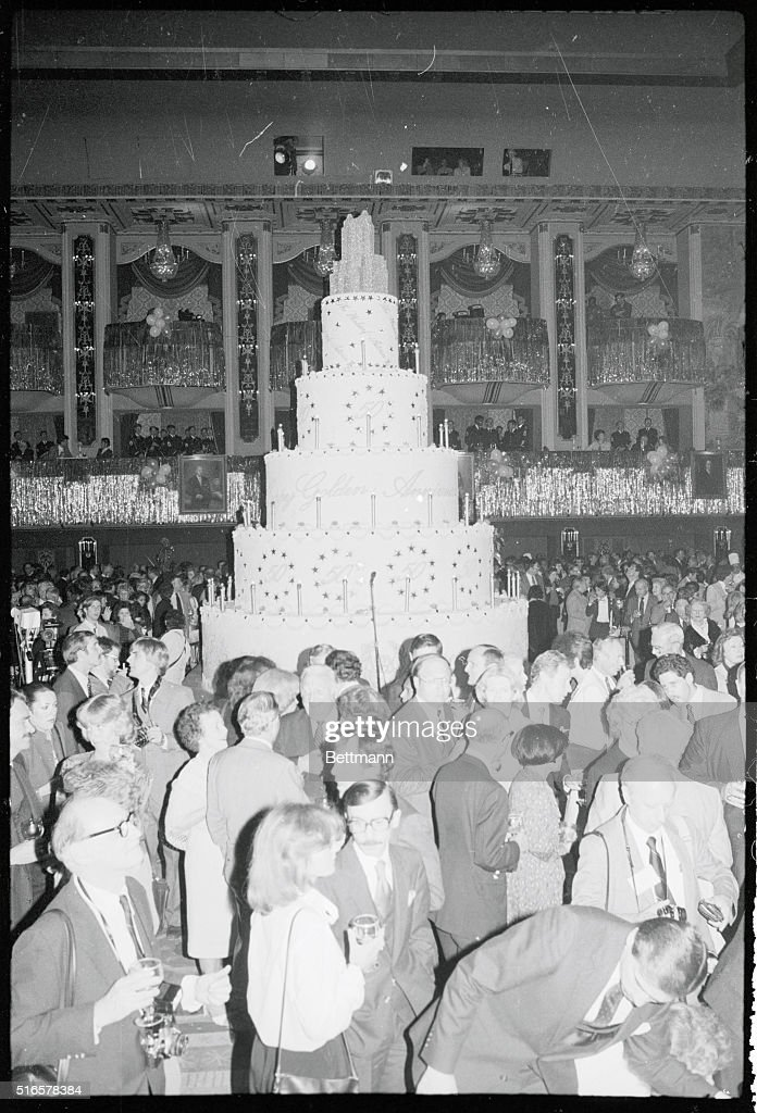 A giant birthday cake sits in the center of the grand ballroom of the WaldorfAstoria Hotel as hundreds of people help to celebrate the 50th...