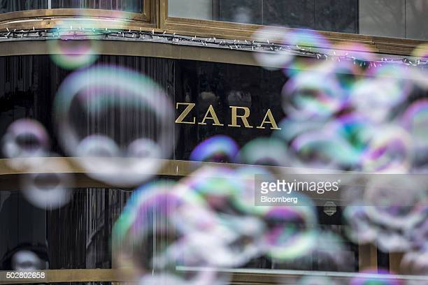 Giant bubbles created by a street artist float past a Zara fashion store operated by Inditex SA in central Prague Czech Republic on Tuesday Dec 29...