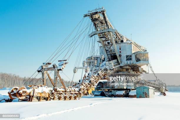 Giant bucket chain excavator wintering in sand quarry