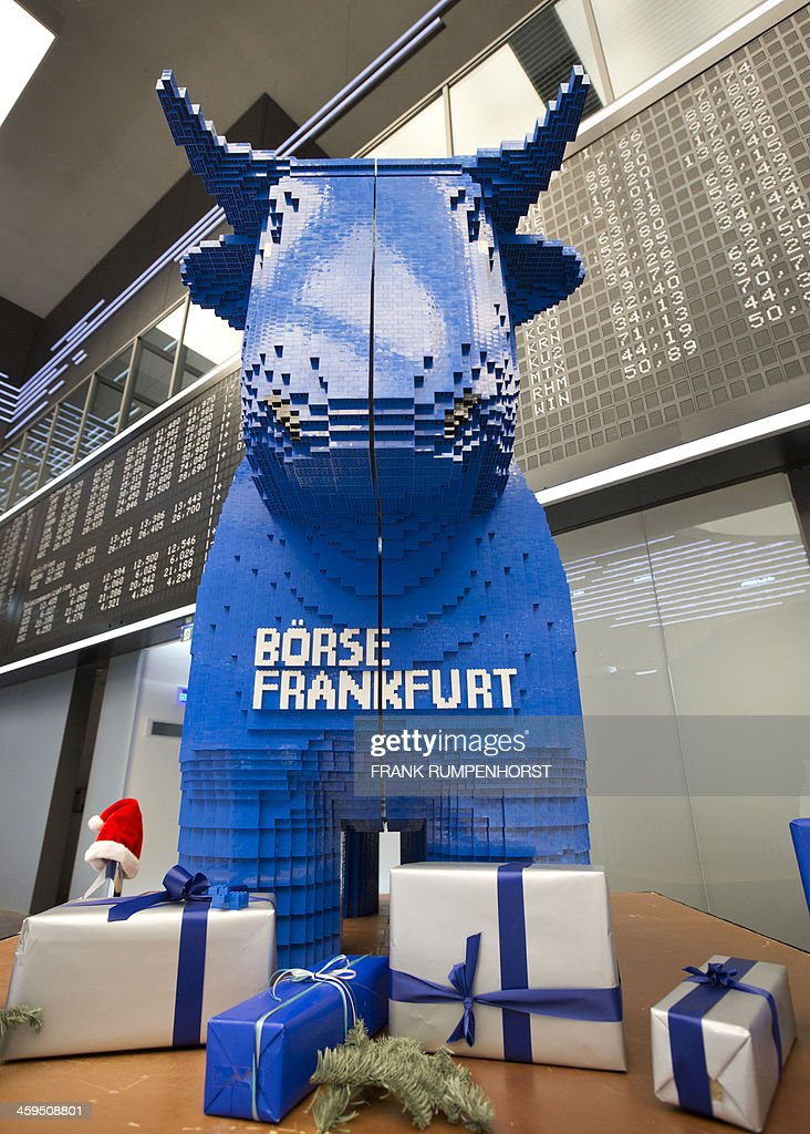 A giant bull made from Lego blocks can be seen on the trading floor of the stock exchange in Frankfurt am Main, central Germany, on December 27, 2013. The Frankfurt Stock Exchange opened in the green as the Dax continued to display new records after three days of closing for Christmas and ahead of the weekend. AFP PHOTO / DPA / FRANK RUMPENHORST +++ GERMANY OUT +++