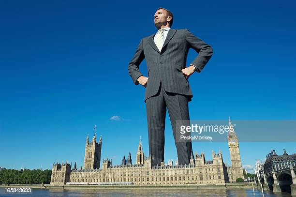 Giant Businessman Towers Over Westminster Palace London