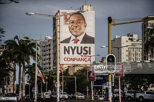 A giant campaign billboard of Mozambican Liberation Front hangs from a building in Avenida Edoardo Modlande on the eve of Mozambican Presidential and...