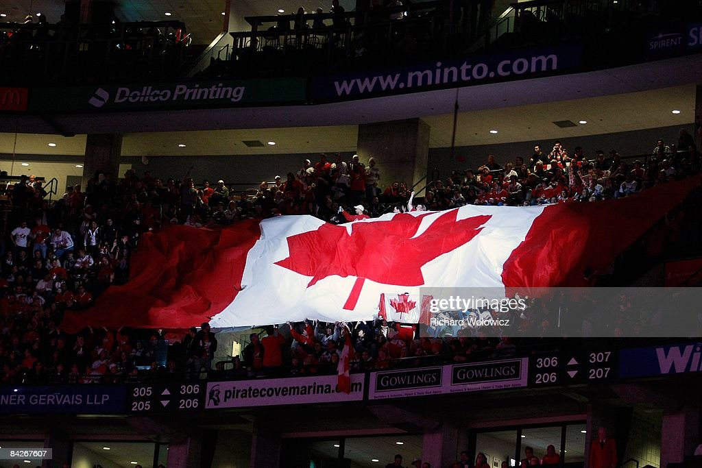 A giant Canadian flag travels through the crowd during pregame ceremonies before the game featuring Team Canada versus Team Czech Republic at the...