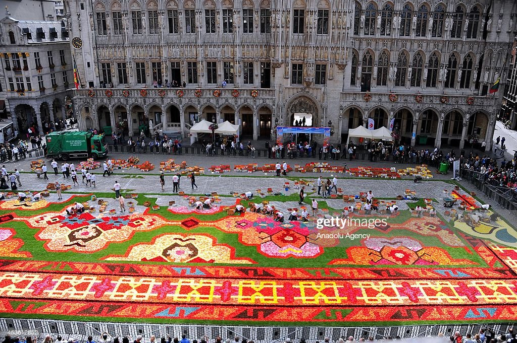 A giant carpet is made with 600,000 begonia flowers within the celebrations of the 50th anniversary of Turkish workers' migration to Belgium at Grand Place in Brussels, Belgium on August 14, 2014. Putting out a 75-meter-length and 25-meter-width carpet, 100 workers work all day to reflect the famous Turkish Usak carpet patterns.