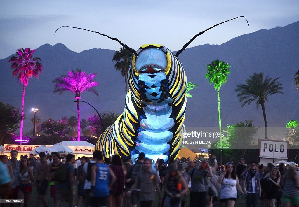 A giant caterpillar moves through the crowd on the first day of the Coachella Music Festival in Indio, California on April 10, 2015.