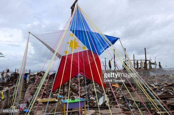 TACLOBAN LEYTE PHILIPPINES DECEMBER 24 A giant Christmas star fashioned out as a Philippine flag sits among debris on Christmas eve on December 24...