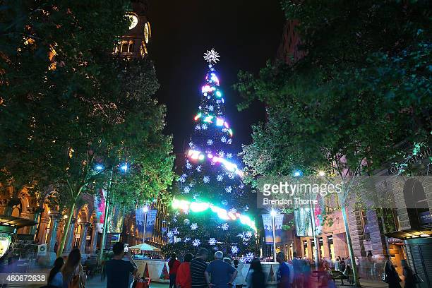 A giant Christmas Tree in Martin Place is illuminated as part of a Christmas lights display in celebration of Christmas on December 19 2014 in Sydney...