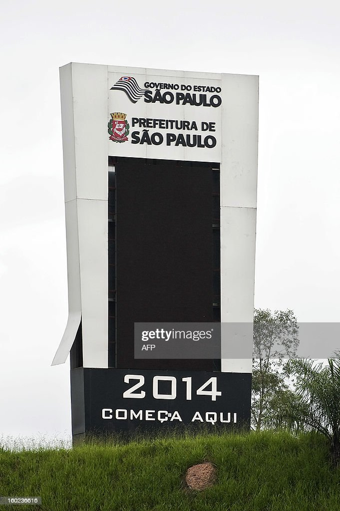 A giant countdown clock tower next to the construction site of Itaquerao stadium, was turned off on January 28, 2013 in Sao Paulo, Brazil, to honor the victims of the eve's nightclub blaze in Santa Maria, southern Brazil, which left more than 230 people dead. The official ceremony to celebrate the 500 days for the start of the FIFA World Cup 2014 scheduled for today was cancelled after a fire in a night club in the southtern city of Santa Maria killed more than 230 people. AFP PHOTO / Nelson ALMEIDA