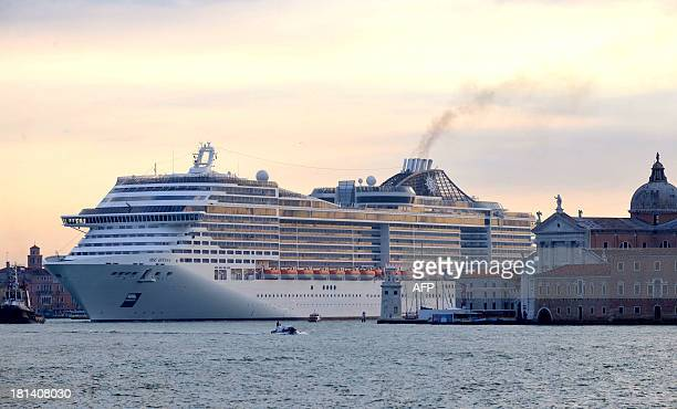 A giant cruiseship arrives in front of SaintMark's square in Venice on September 21 2013 The 'No Big Ships' comittee is to stage a canalbank protest...