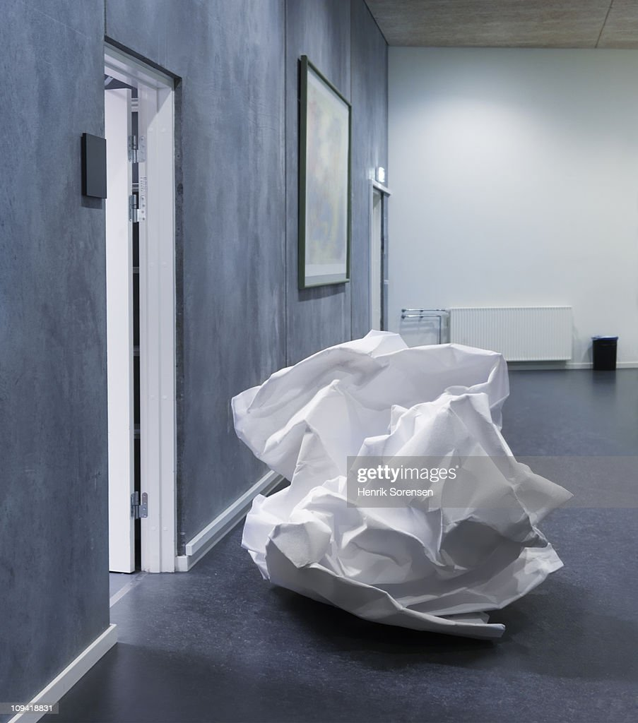 Giant crumpled up paper waste lying in office