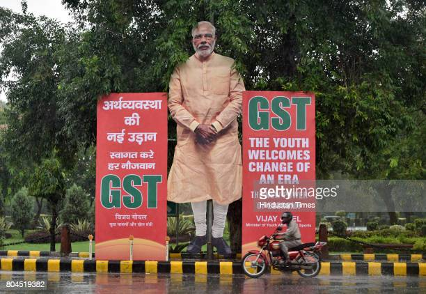 A giant cutout of Prime Minister Narendra Modi installed at Ashok Road in favour of GST on June 30 2017 in New Delhi India With a gong sound at...