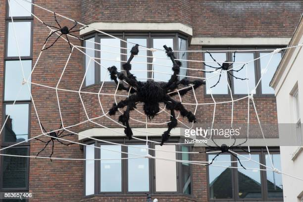 A giant decoration spider is pictured Newburgh Quarter in the Carnaby Street area to get ready to celebrate Halloween London on October 20 2017