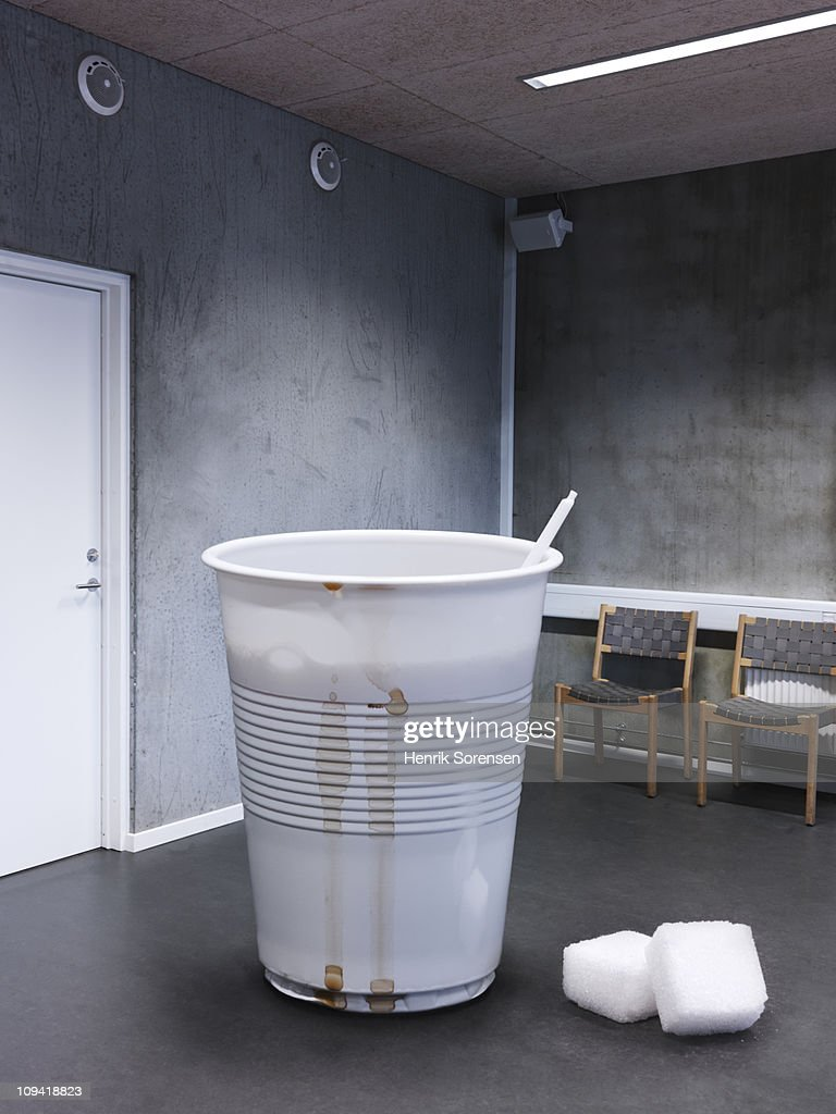 Giant disposable coffee cup in office