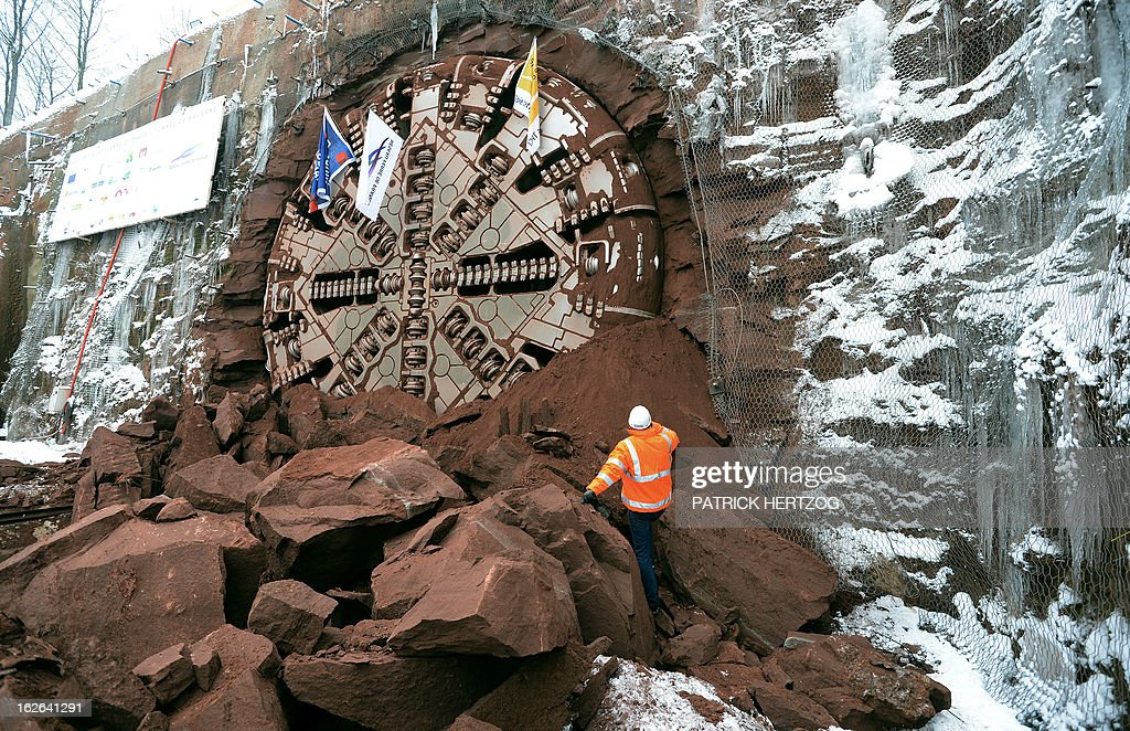 A giant drilling machine completes the 4 kilometre-long Saverne tunnel beneath the Vosges mountains in Eckartswiller, eastern France during a ceremony on February, 25, 2013, as part of the second phase of construction works for the east European high speed train line (LGV) between Paris and Strasbourg. The line is to bound in 2016 Paris and Strasbourg in 1h50 at a speed of 320 km per hour.