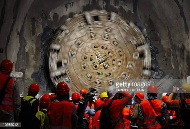 A giant drilling machine completes the world's longest tunnel beneath the Swiss Alps during a ceremony on October 15 30 kilometres from one end and...