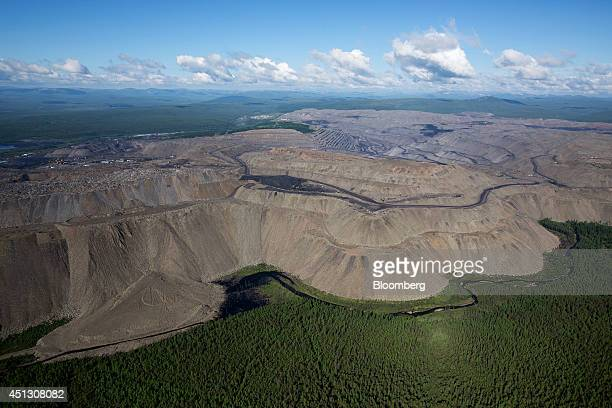 Giant dumps of rock waste surround the open pit excavations of coking coal at the Neryungrinsky mine operated by OAO Mechel in this aerial view in...