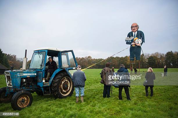 A giant effigy of the suspended president of FIFA Sepp Blatter created by British artist Frank Shepherd of the Edenbridge Bonfire Society is erected...