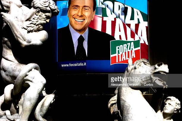 A giant electoral billboard depicting a smiling Italian Prime Minister Silvio Berlusconi hangs on a buiding in front of the famous Bernini Sculptures...