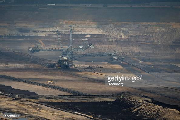 A giant excavator operates at an open pit lignite mine also known as brown coal operated by RWE AG in Hambach Germany on Monday 7 Sept 2015 German...