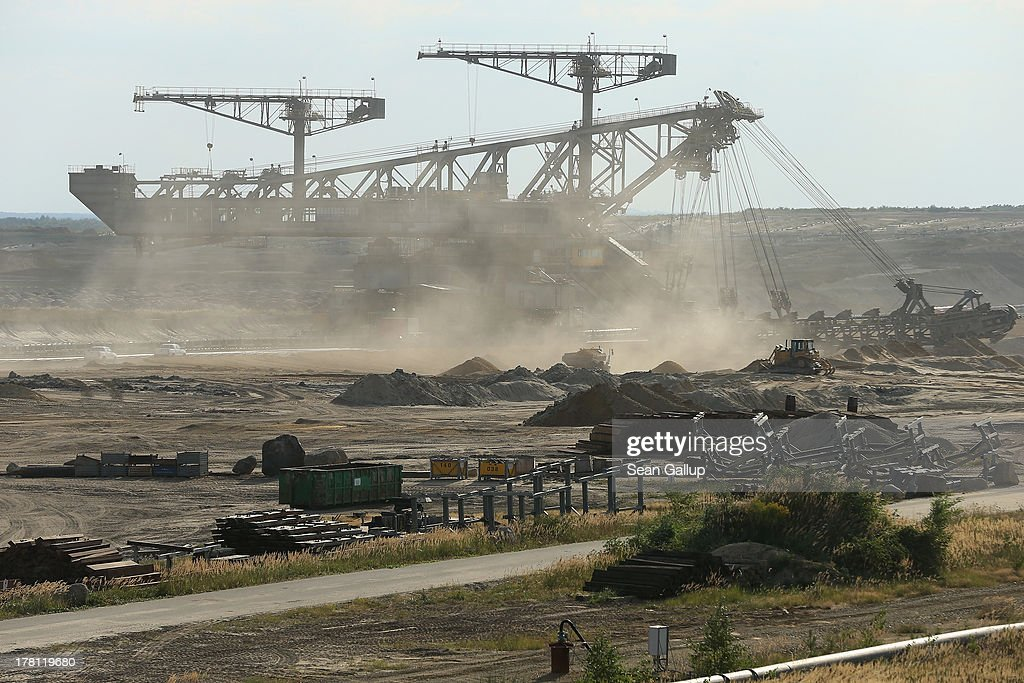 A giant excavator stands at the Welzow Sued open-pit lignite coal mine on August 26, 2013 near Welzow, Germany. Welzow Sued, operated by Vattenfall, is among the last active open-pit mines in a region known as the Lausitzer Seenland, where dozens of former mines have been turned into lakes. In a development project initiated by state government, former open-pit mines that once evoked a lunar landscape are being turned into lakes in a long-term rejuvenation effort that is also intended to make the area a viable tourist destination. Mineral residue in the mines, however, is proving a difficult stumbling block that is making many of the new lakes too acidic to sustain marine life in the short term.