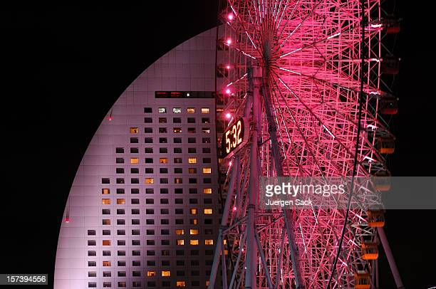 Giant ferris wheel meets modern building