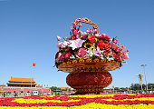 A giant flower bed gets decorated for the upcoming National Day at Tian'anmen Square on September 25 2015 in Beijing China Tian'anmen has prepared...