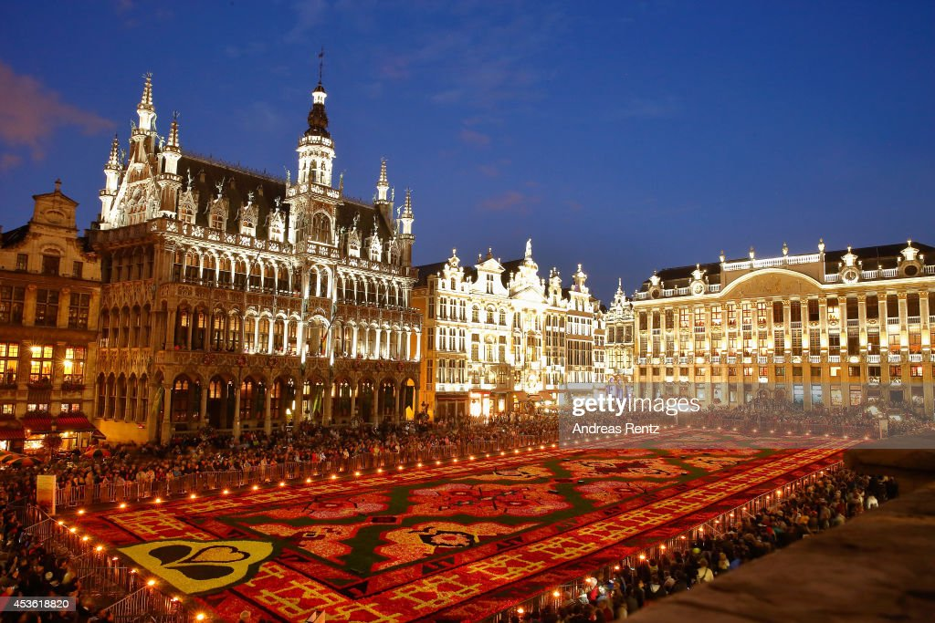A giant flower carpet is pictured within the celebrations of the 50th anniversary of Turkish workers' migration to Belgium at the Grand Place next to the town hall on August 14, 2014 in Brussels, Belgium. This year nearly 750,000 begonias were needed to decorate on 1800 square meter the Grand Place.
