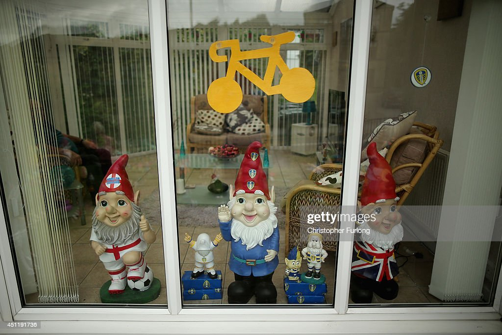Giant gnomes and a yellow cycle decorate the window of a house on route two as Yorkshire prepares to host the Tour de France Grand Depart, on June 24, 2014 in Haworth, United Kingdom. The people of Yorkshire are preparing to give the riders of the 2014 Tour de France a grand welcome as the route of stages one and two are decorated with bunting, bikes and yellow jerseys The Grand Depart of the 2014 Tour De France is taking place in Leeds with the first two stages taking place across Yorkshire on 6th and 7th of July.
