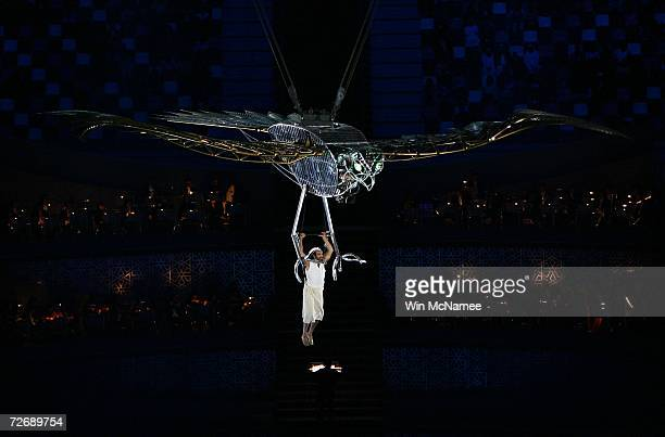 A giant golden eagle carris a young man as the birth of the universe is reenacted during a rehearsal at Khalifa Stadium for the Opening Ceremony of...