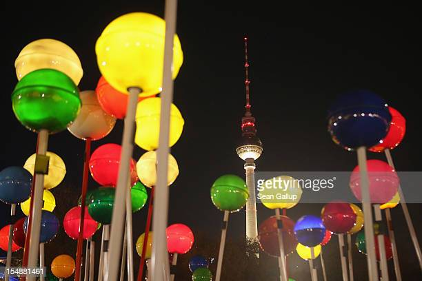 Giant illuminated pins stand on a painted map of Berlin in 1775 scale as the broadcast tower at Alexanderplatz looms behind during celebrations...