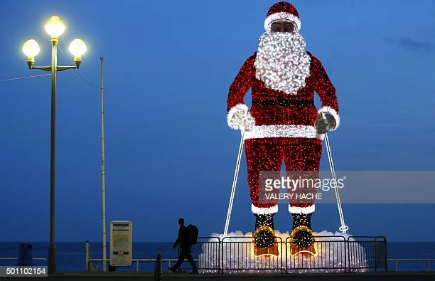 TOPSHOT A giant illuminated Santa Claus model is displayed along the 'Promenade des Anglais' in the French Riviera city of Nice southeastern France...