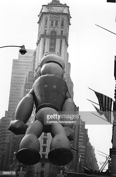 A giant inflatable Popeye floating over Times Square New York during a Thanksgiving Parade