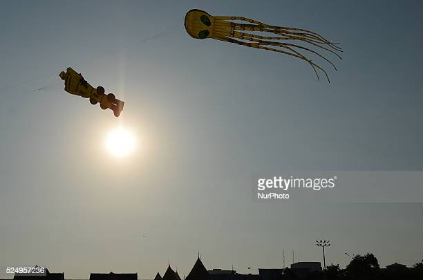 Giant kites flying during the Kite Festival at Sanam Luang in Bangkok Thailand on April 17 2015 the Kite Festival hold on 1721 April to celebrate the...