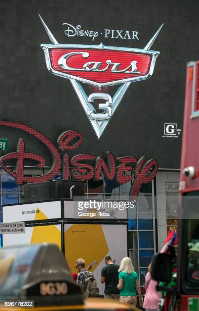 A giant LED video screen above the Disney store in Times Square promotes the new Pixar 'Cars 3' movie on June 10 2017 in New York New York With a...