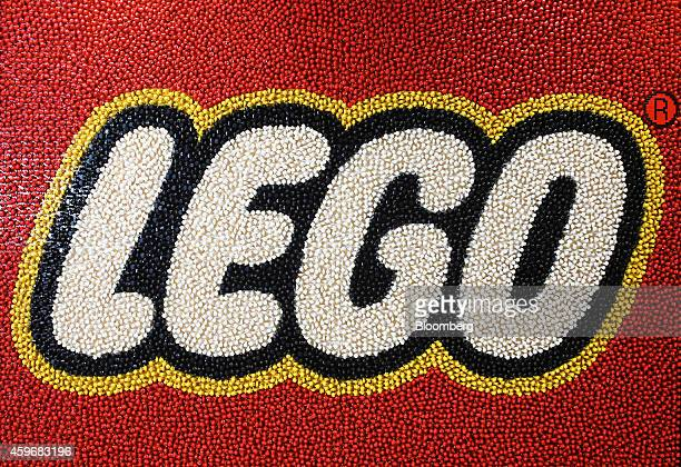 A giant Lego logo made of colored Lego figures sits on a wall inside the new Lego A/S office in London UK on Friday Nov 28 2014 Lego is 'very...