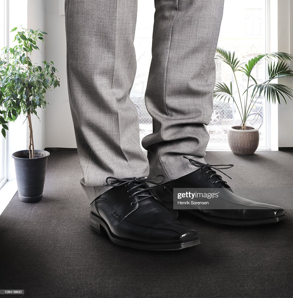 Giant legs and feet inside office building
