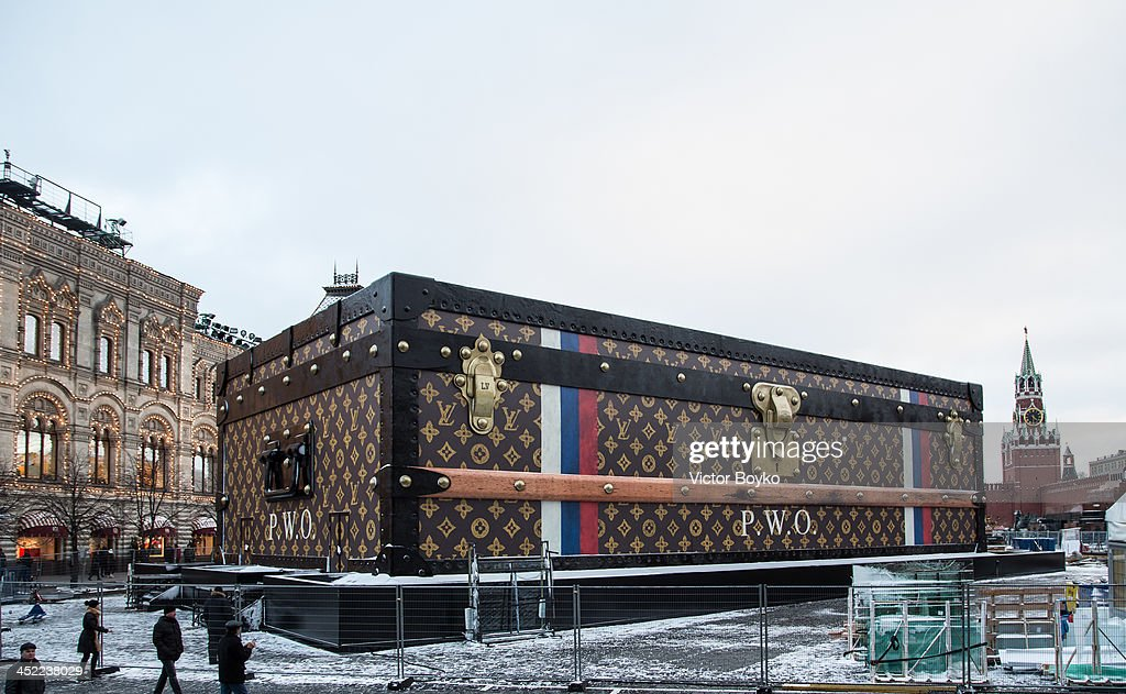 A giant Louis Vuitton suitcase is situated in Red Square in Moscow on November 27, 2013 in Moscow, Russia. The huge suitcase was assembled in the heart of Moscow near the Kremlin as a part of the upcoming exhibition to mark the famous owners of the iconic Louis Vuitton trademark.