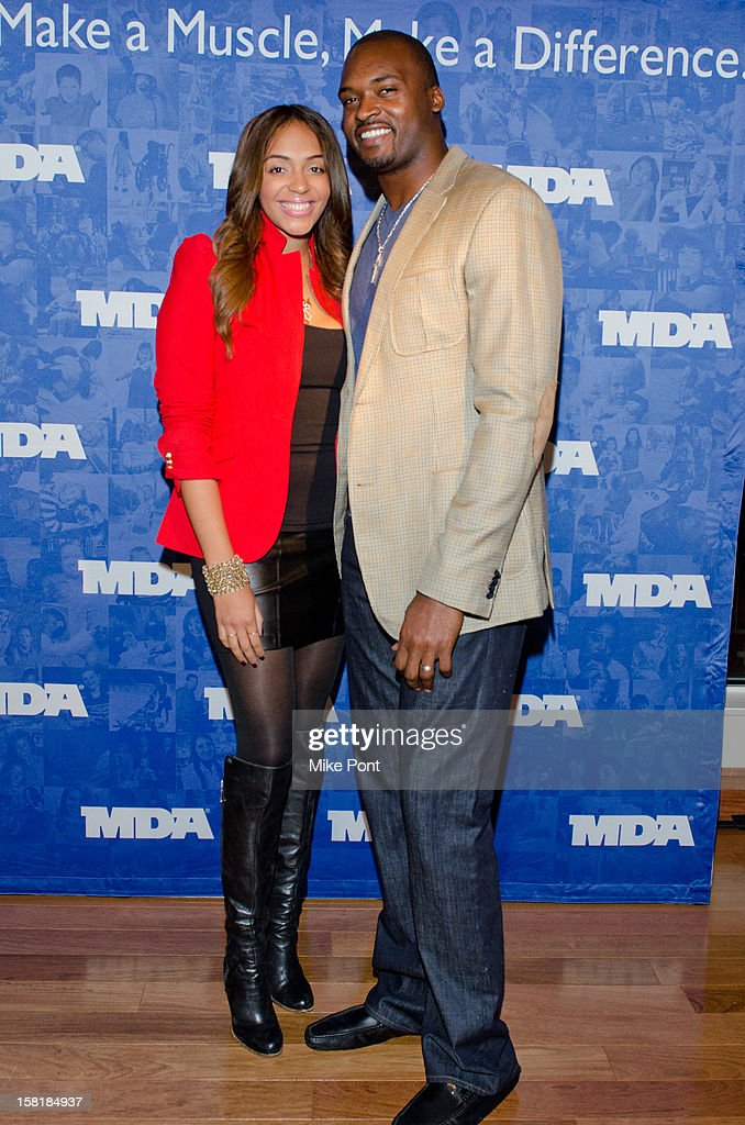 NY Giant <a gi-track='captionPersonalityLinkClicked' href=/galleries/search?phrase=Mathias+Kiwanuka&family=editorial&specificpeople=451548 ng-click='$event.stopPropagation()'>Mathias Kiwanuka</a> (R) attends MDA's 2013 Muscle Team Kick Off Event at The Lighthouse at Chelsea Piers on December 10, 2012 in New York City.