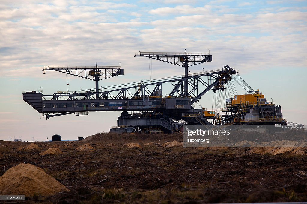 A giant mining conveyor machine stands at a open-pit lignite mine operated by Vattenfall AB in Welzow-Sued, Germany, on Saturday, Jan. 11, 2014. Across the continent's mining belt, from Germany to Poland and the Czech Republic, utilities such as Vattenfall AB, CEZ AS and PGE SA are expanding open-pit mines that produce lignite. Photographer: Krisztian Bocsi/Bloomberg via Getty Images