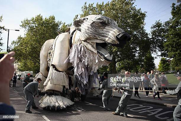 A giant model of a Polar Bear is moved from its position outside the Shell building after Actress Emma Thomson joined Greenpeace climate change...